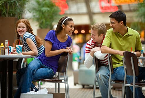 Teens talking in mall food court