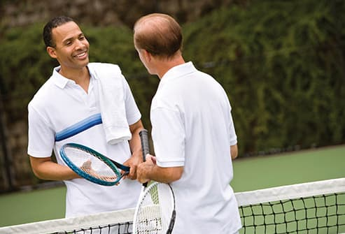 two men talking as tennis opponents
