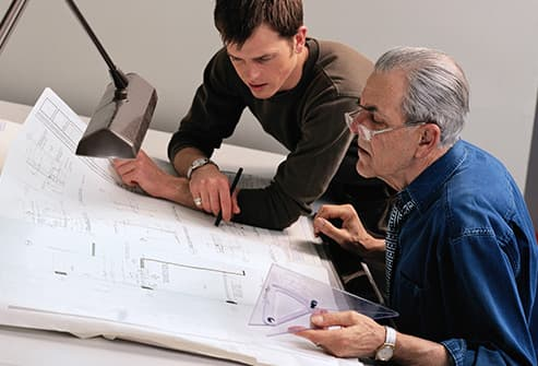 senior architect at drafting table