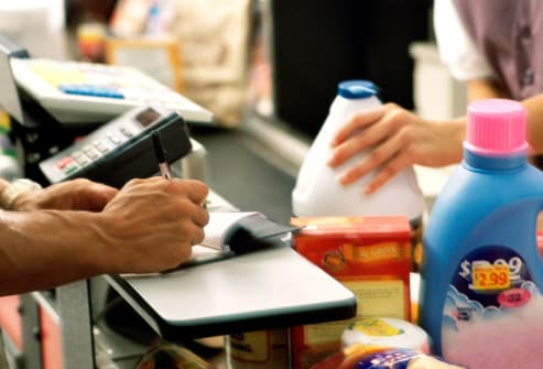 writing check in grocery checkout