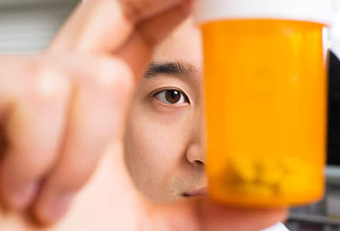 Close up of man examining medications