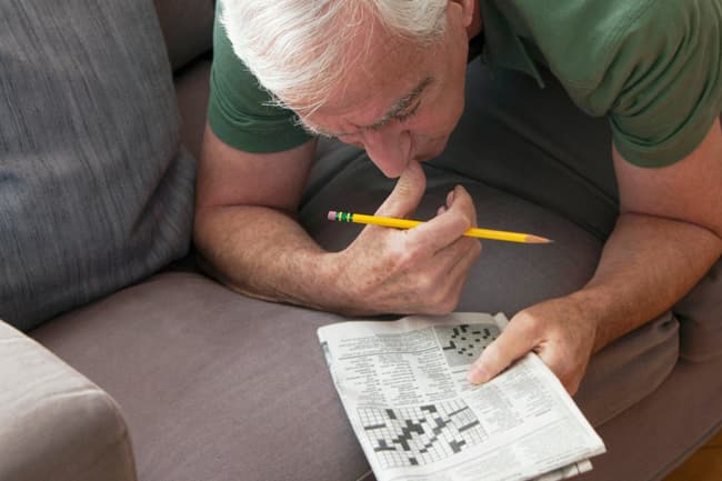 man working crossword