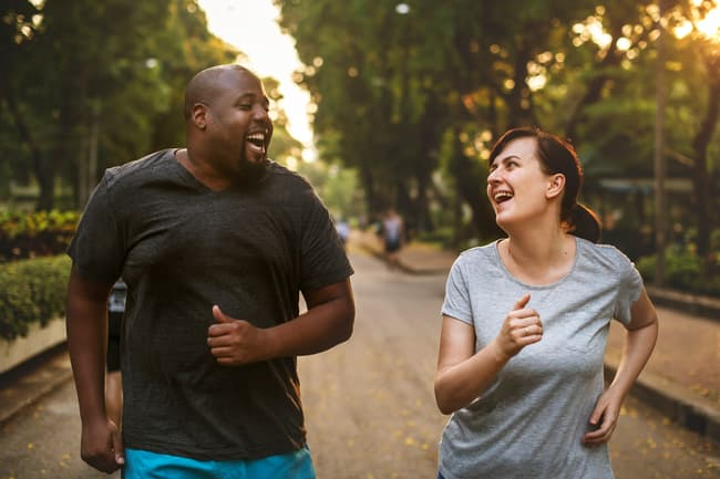 photo of couple jogging