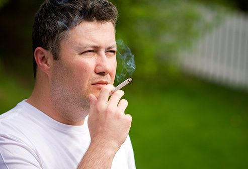 man smoking close up