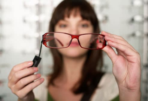 Woman Looking Through Glasses