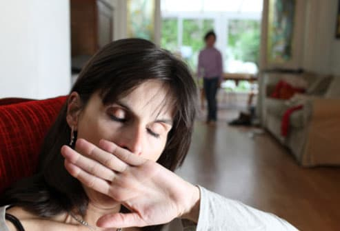 Woman Yawning At Home