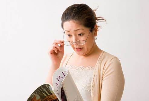 woman reading magazine