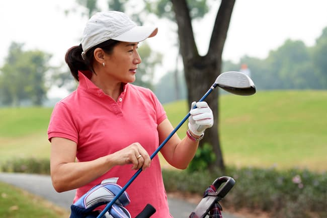 photo of woman playing golf