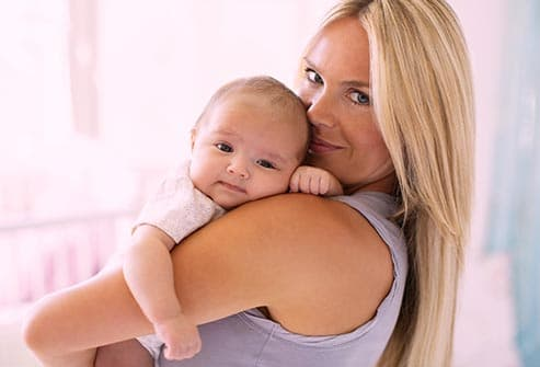 smiling woman and newborn