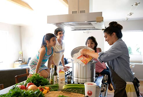 family cooking soup