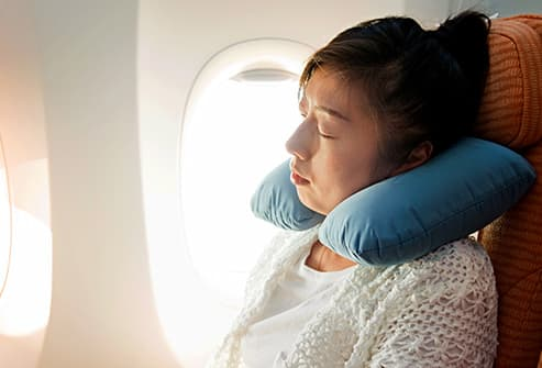 woman with neck pillow