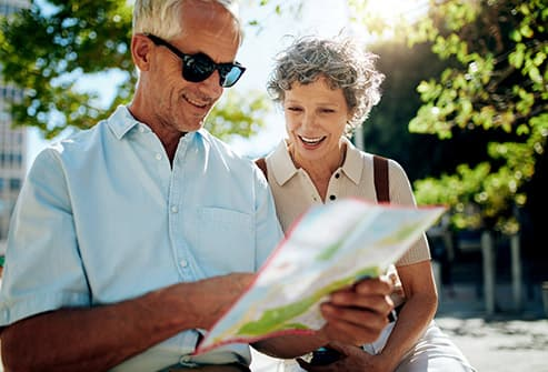 mature couple looking at map