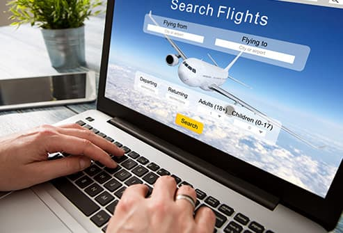 person searching for flights