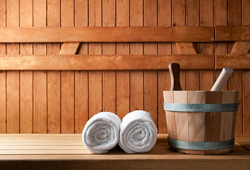 sauna bucket and towels