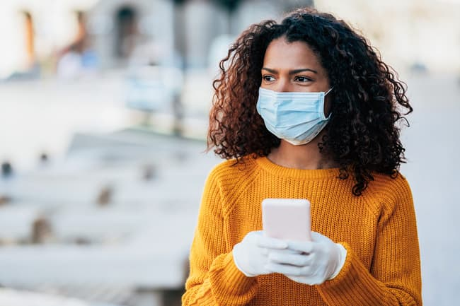photo of woman wearing mask and gloves