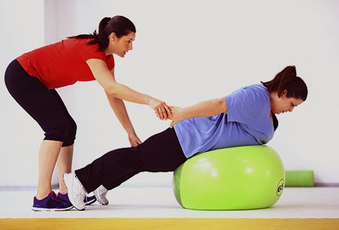 woman stretching with therapist
