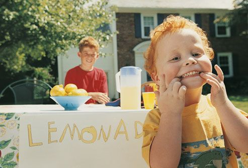 Smiling Kids at Lemonade Stand