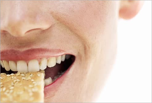 Woman Eating Cracker