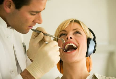 Woman wearing headphones at dentist