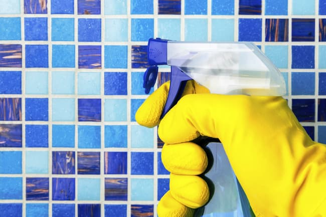 photo of cleaning bathroom tiles