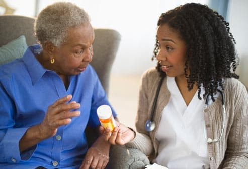 nurse talking to older woman