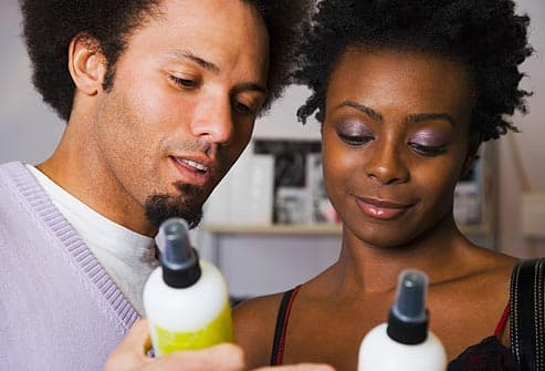 Couple looking at hair product
