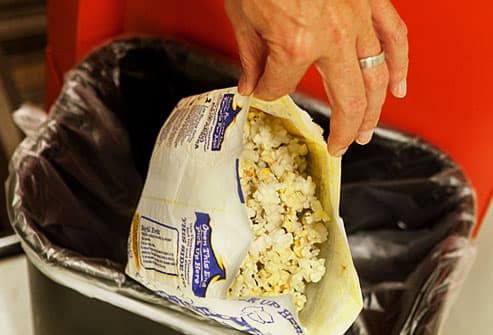 Throwing Away Bag of Popcorn
