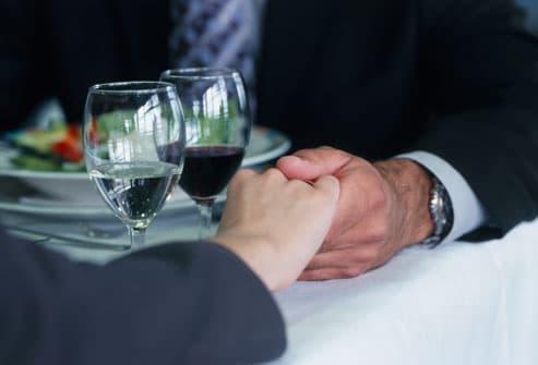 holding hands at table