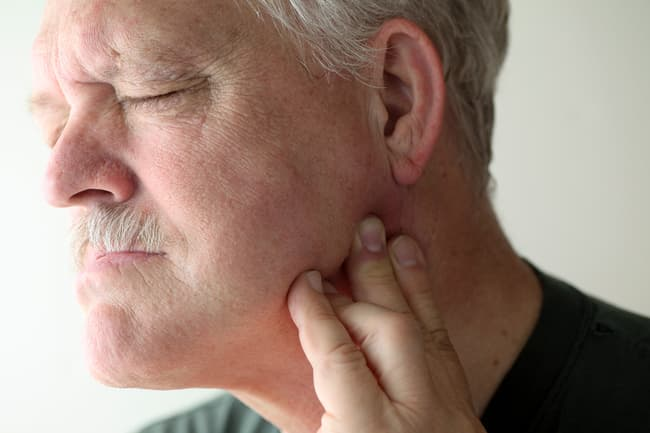 photo of man with jaw pain