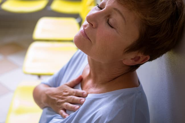 photo of mature woman with chest pain