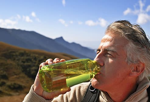 Mature man drinking water from bottle