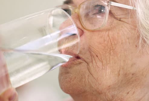 Senior Woman Drinking Glass Of Water