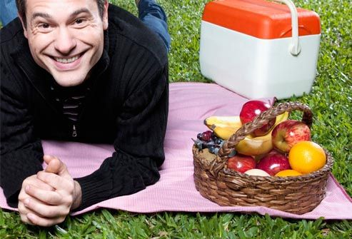 man with picnic basket full of fruit