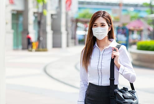 photo of young woman wearing mask
