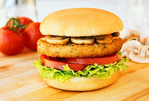 Veggie burger with mushroom, lettuce  and tomato