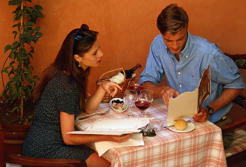 Couple in restaurant reading menu