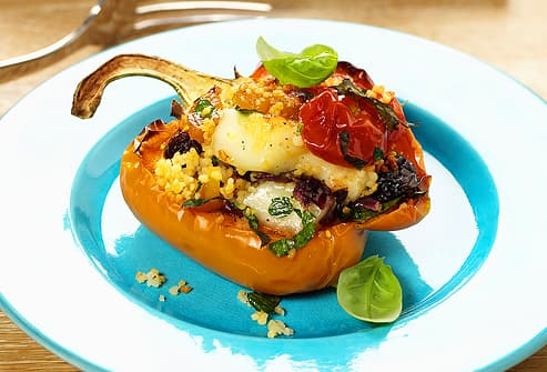 Pepper half stuffed with couscous and vegetables
