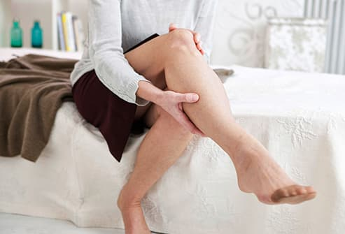 woman massaging sore calf