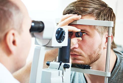 man receiving opthalmogy exam