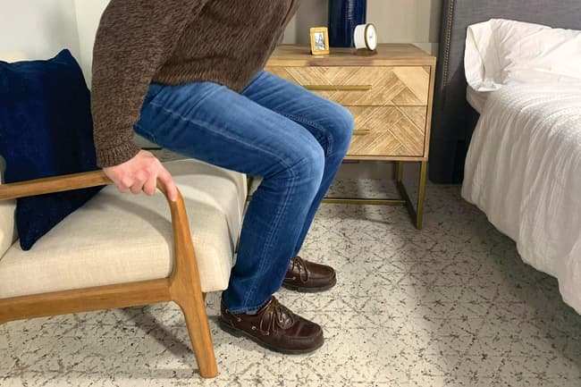 man rising from chair