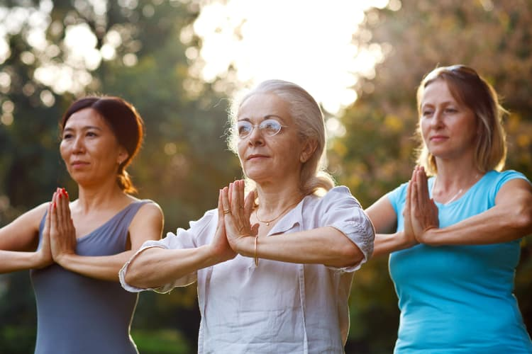 photo of mature women in yoga class