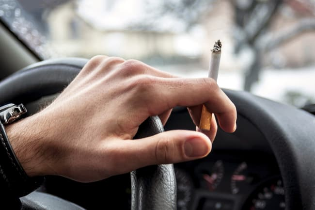 photo of smoking and driving