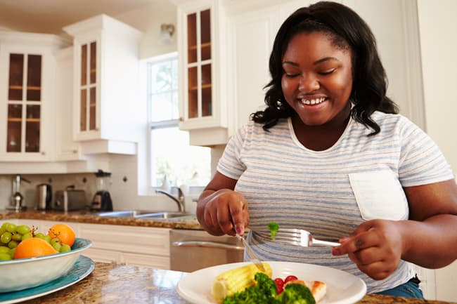 photo of woman eating healthy meal