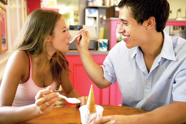 young couple sharing a sundae