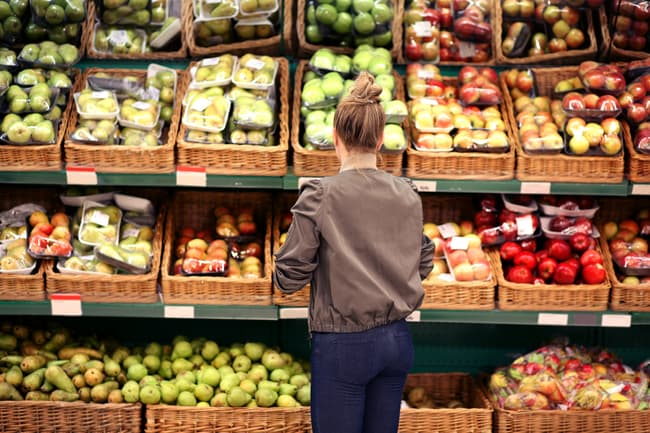 photo of woman looking at produce