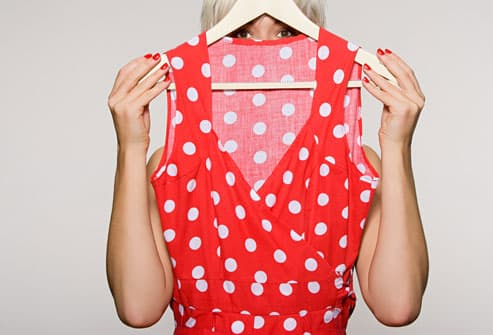 Woman Holding Polka Dot Dress