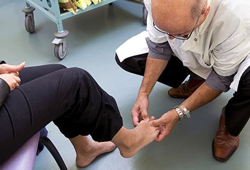 woman examined by podiatrist