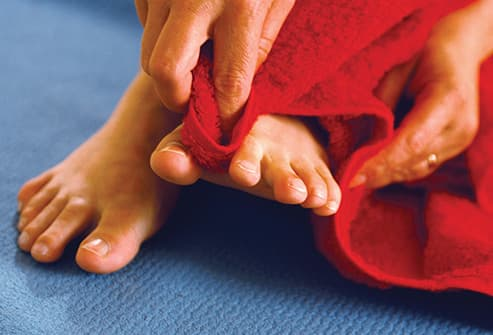 drying bare feet with towel
