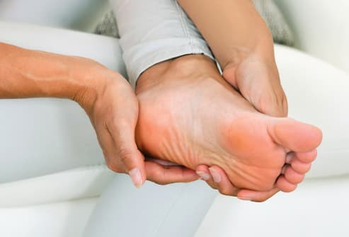 woman inspecting foot close up
