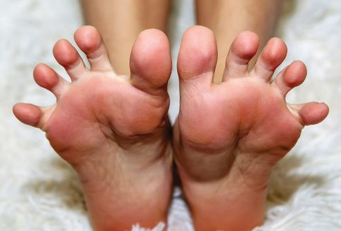 woman stretching feet